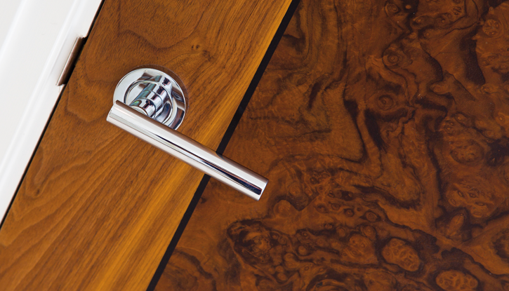 <strong>Luxury residential development, Surrey</strong> - Door in American Walnut and Walnut Burr with Black Inlays, 44mm solid core FD30 doors